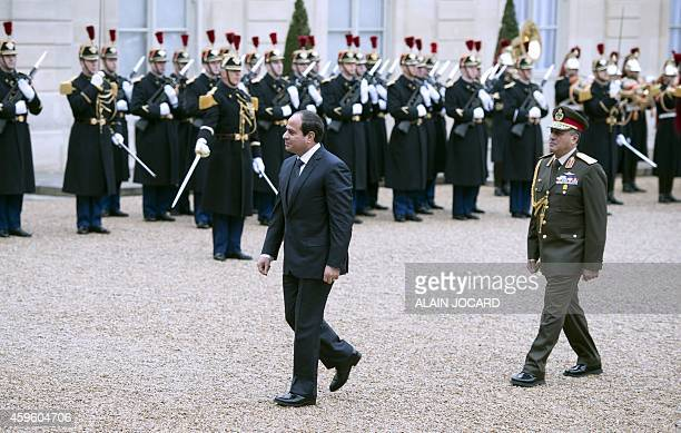 Egyptian President Abdel Fattah alSisi reviews an honour guard upon his arrival for a meeting at the Elysee presidential palace in Paris on November...