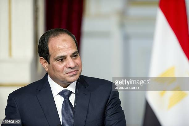 Egyptian President AbdelFattah alSisi gives a joint statement with French President Francois Hollande at the Elysee Palace on November 26 in Paris...
