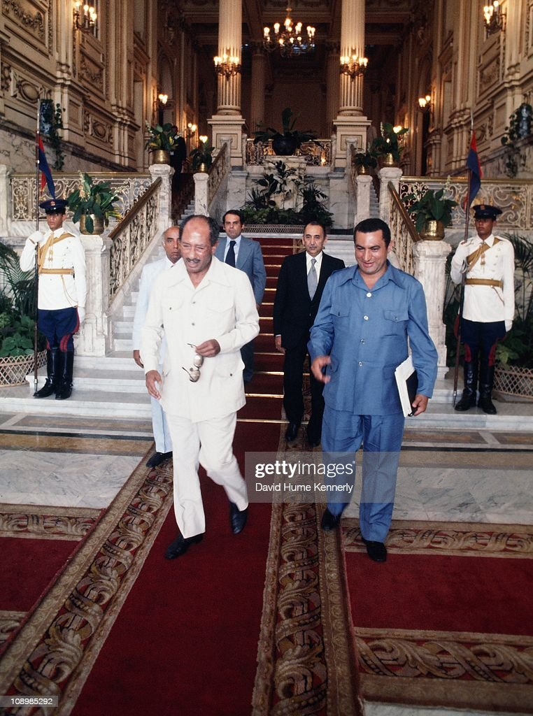 Egyptian President Anwar al Sadat (1918 - 1981) and Vice-President <a gi-track='captionPersonalityLinkClicked' href=/galleries/search?phrase=Hosni+Mubarak&family=editorial&specificpeople=201752 ng-click='$event.stopPropagation()'>Hosni Mubarak</a> walk through the halls of King Farouk's Palace in Cairo, Egypt, 1977.