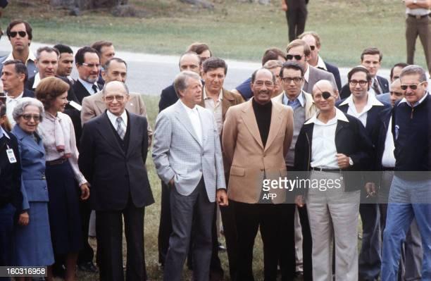 Egyptian President Anwar alSadat surrounded by Aliza Begin Rosalyn Carter Israeli Premier Menachem Begin US President Jimmy Carter Israeli Foreign...