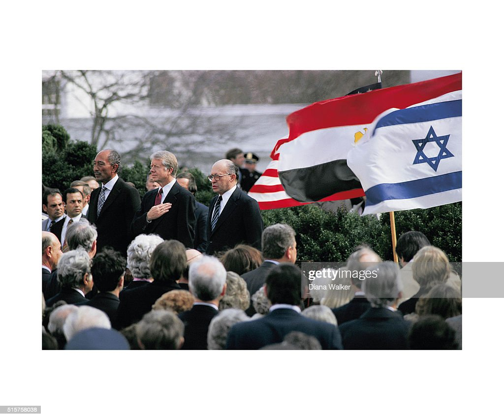 Egyptian President Anwar al-Sadat, United States President <a gi-track='captionPersonalityLinkClicked' href=/galleries/search?phrase=Jimmy+Carter+-+US+President&family=editorial&specificpeople=93589 ng-click='$event.stopPropagation()'>Jimmy Carter</a> and Israeli Premier <a gi-track='captionPersonalityLinkClicked' href=/galleries/search?phrase=Menachem+Begin&family=editorial&specificpeople=93758 ng-click='$event.stopPropagation()'>Menachem Begin</a> are photographed before signing the Egypt-Israel Peace Treaty on the north lawn of the White House on March 26, 1979 in Washington, DC.