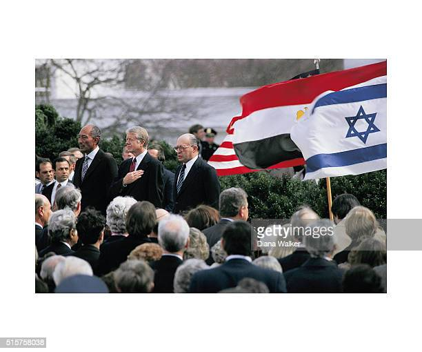 Egyptian President Anwar alSadat United States President Jimmy Carter and Israeli Premier Menachem Begin are photographed before signing the...