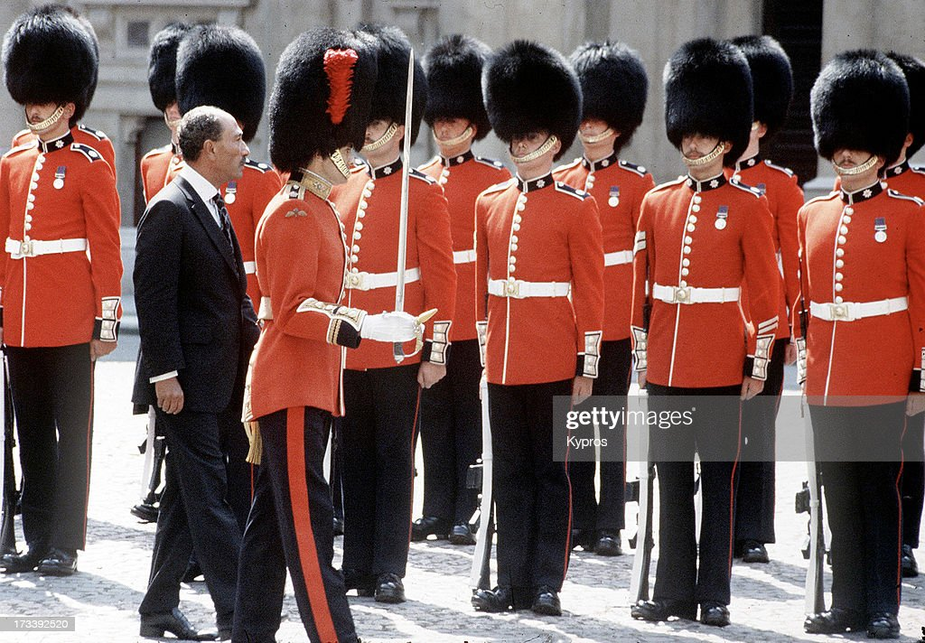 Egyptian president Anwar Sadat inspects the Grenadier Guards during a visit to London, circa 1981.
