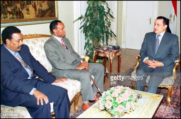 Egyptian President Hosni Mubarak confers 29 May in Cairo with the leaders of the two main Somali factions Hussein Mohammad Aidid and Ali Mohammed...