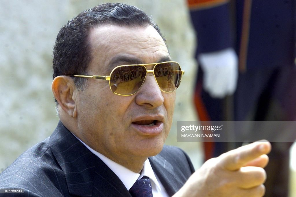 Egyptian President Hosni Mubarak gestures as he talks to reporters after laying the foundation stone of Egypt's new museum 04 February 2002. Mubarak hoped the Palestinian administration would do its utmost to stop violence to avoid giving Israel and excuse to ignore previous agreement. AFPPHOTO/Marwan NAAMANI