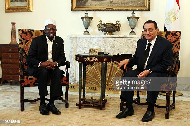 Egyptian President Hosni Mubarak meets with Somalia President Sheikh Sharif Sheikh Ahmed in the presidential place in Cairo on July 18 2010 AFP...