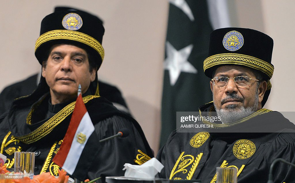 Egyptian President Mohamed Morsi (R) and Pakistani Prime Minister Raja Pervez Ashraf attend a special convocation during his visit the National University of Science and Technology in Islamabad on March 18, 2013. Morsi arrived in Pakistan on March 18, on a South Asian tour that will also take in India as he works to promote trade and investment in his nation's troubled economy. Morsi's one-day trip to Pakistan is the first by an Egyptian leader since Gamal Abdel Nasser in the 1960s, Pakistan's foreign ministry said.