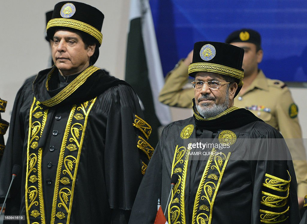 Egyptian President Mohamed Morsi (R) and Pakistani Prime Minister Raja Pervez Ashraf observe their national anthems during a special convocation at the National University of Science and Technology in Islamabad on March 18, 2013. Morsi arrived in Pakistan on March 18, on a South Asian tour that will also take in India as he works to promote trade and investment in his nation's troubled economy. Morsi's one-day trip to Pakistan is the first by an Egyptian leader since Gamal Abdel Nasser in the 1960s, Pakistan's foreign ministry said.