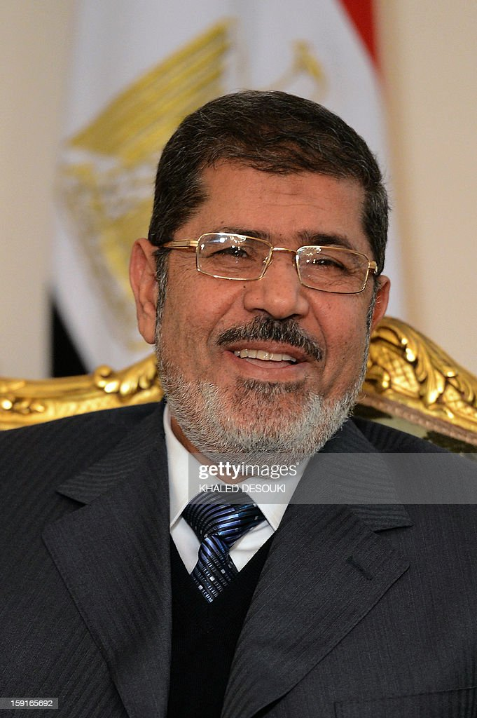 Egyptian President Mohamed Morsi is seen during his meeting with Palestinian president Mahmud Abbas in Cairo on January 9, 2013. Abbas and Palestinian Hamas leader Khaled Meshaal are holding separate talks with Morsi before they meet each other to discuss the implementation of a unity pact signed in 2011, officials said.