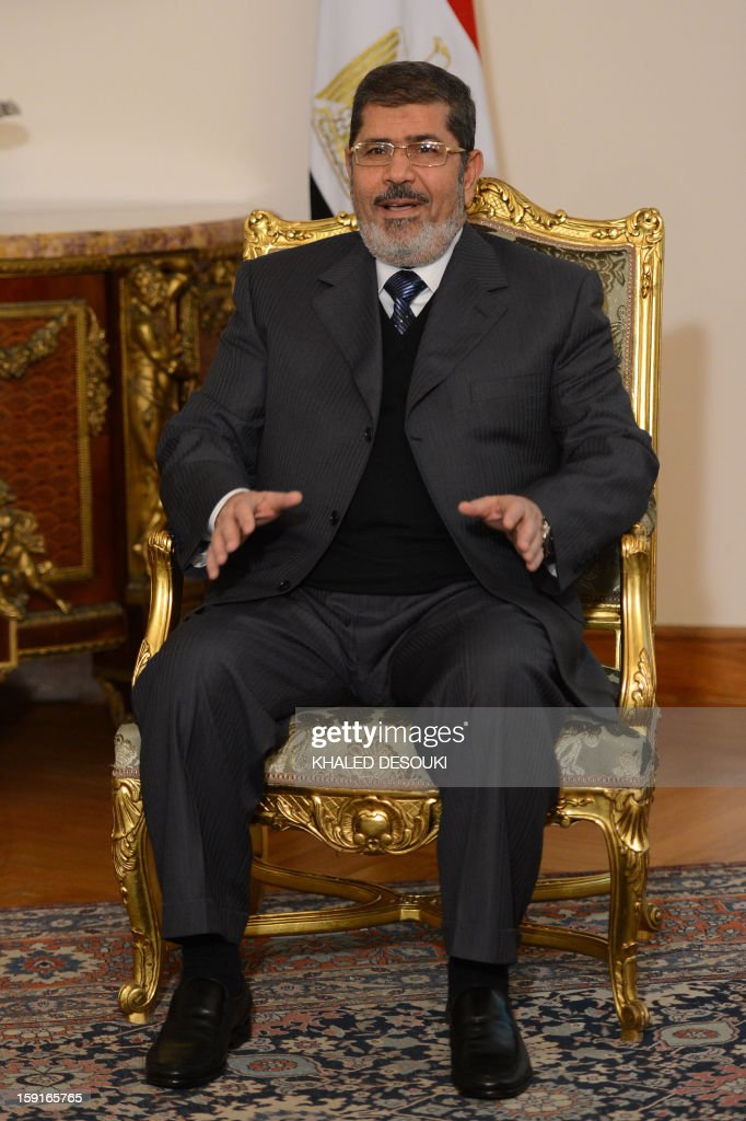 Egyptian President Mohamed Morsi is seen during his meeting with Palestinian president Mahmud Abbas in Cairo on January 9, 2013. Abbas and Palestinian Hamas leader Khaled Meshaal are holding separate talks with Morsi before they meet each other to discuss the implementation of a unity pact signed in 2011, officials said. AFP PHOTO / KHALED DESOUKI