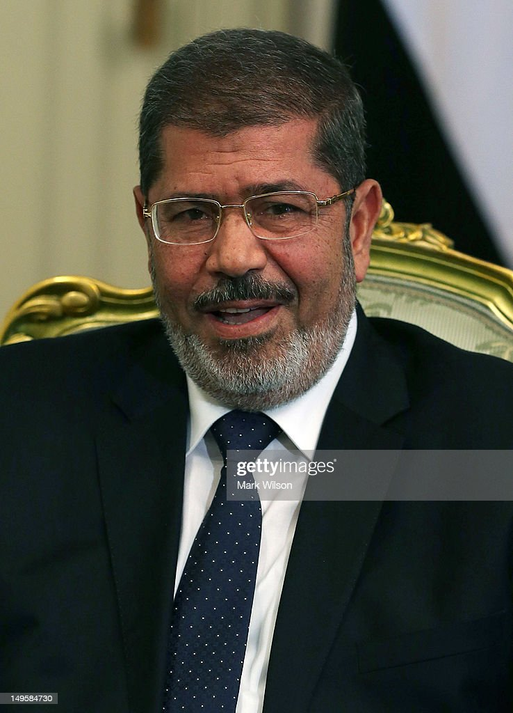 Egyptian President Mohamed Morsi participates in a meeting U.S. Secretary of Defense Leon Panetta, at the Presidential Palace on July 31, 2012 in Cairo, Egypt. Secretary Panetta is on a four day trip to the Middle-East with stops in Tunisia, Egypt, Israel and Jordan before returning to Washington.