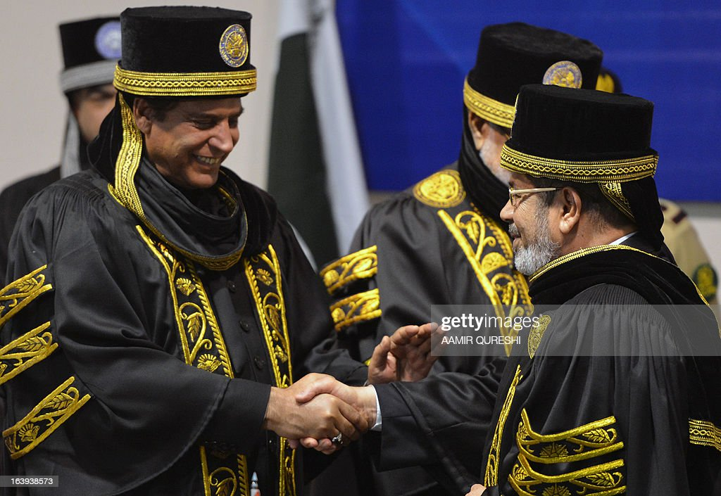 Egyptian President Mohamed Morsi (R) shakes hands with Pakistan's Prime Minister Raja Pervez Ashraf (L) after he was conferred with an honourary doctor of philosophy during his visit to the National University of Science and Technology in Islamabad on March 18, 2013. Morsi arrived in Pakistan on March 18, on a South Asian tour that will also take in India as he works to promote trade and investment in his nation's troubled economy. Morsi's one-day trip to Pakistan is the first by an Egyptian leader since Gamal Abdel Nasser in the 1960s, Pakistan's foreign ministry said.