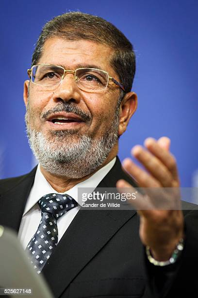Egyptian President Mohamed Morsi speaks to the press prior to a meeting at the EU headquarters in Brussels on Thursday Sept 13 2012 hand vertical...