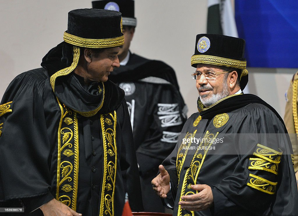 Egyptian President Mohamed Morsi (R) speaks with Pakistan's Prime Minister Raja Pervez Ashraf (L) after receiving a degree of doctor of philosophy during his visit to the National University of Science and Technology in Islamabad on March 18, 2013. Morsi arrived in Pakistan on March 18, on a South Asian tour that will also take in India as he works to promote trade and investment in his nation's troubled economy. Morsi's one-day trip to Pakistan is the first by an Egyptian leader since Gamal Abdel Nasser in the 1960s, Pakistan's foreign ministry said.