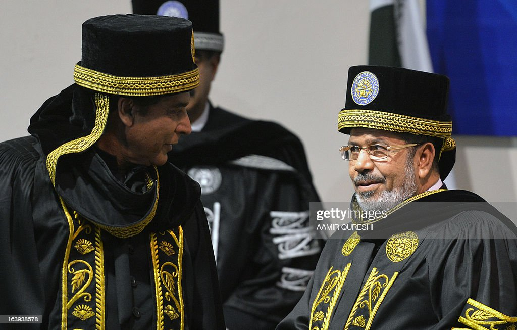 Egyptian President Mohamed Morsi (R) speaks with Pakistan's Prime Minister Raja Pervez Ashraf (L) after receiving a degree of doctor of philosophy during his visit to the National University of Science and Technology in Islamabad on March 18, 2013. Morsi arrived in Pakistan on March 18, on a South Asian tour that will also take in India as he works to promote trade and investment in his nation's troubled economy. Morsi's one-day trip to Pakistan is the first by an Egyptian leader since Gamal Abdel Nasser in the 1960s, Pakistan's foreign ministry said. AFP PHOTO/ AAMIR QURESHI