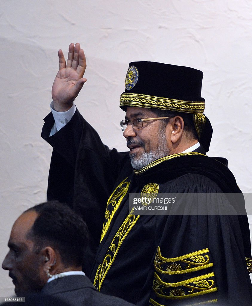 Egyptian President Mohamed Morsi waves as he leaves following his address at the National University of Science and Technology in Islamabad on March 18, 2013. Morsi arrived in Pakistan on March 18, on a South Asian tour that will also take in India as he works to promote trade and investment in his nation's troubled economy. Morsi's one-day trip to Pakistan is the first by an Egyptian leader since Gamal Abdel Nasser in the 1960s, Pakistan's foreign ministry said.