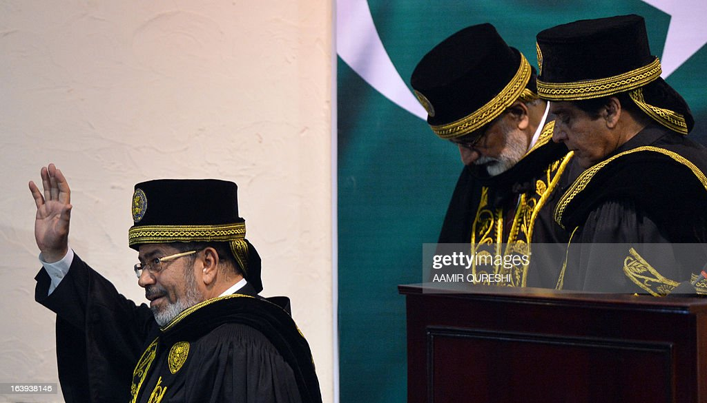 Egyptian President Mohamed Morsi (L) waves as he leaves with Pakistani Prime Minister Raja Pervez Ashraf (R) after his address at the National University of Science and Technology in Islamabad on March 18, 2013. Morsi arrived in Pakistan on March 18, on a South Asian tour that will also take in India as he works to promote trade and investment in his nation's troubled economy. Morsi's one-day trip to Pakistan is the first by an Egyptian leader since Gamal Abdel Nasser in the 1960s, Pakistan's foreign ministry said.