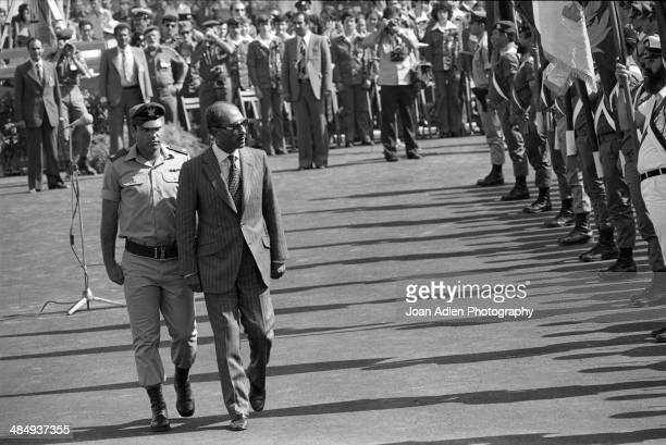 Egyptian President Muhammad Anwar El Sadat ceremonially inspects the troops before holding peace talks at BenGurion University of the Negev on May 28...