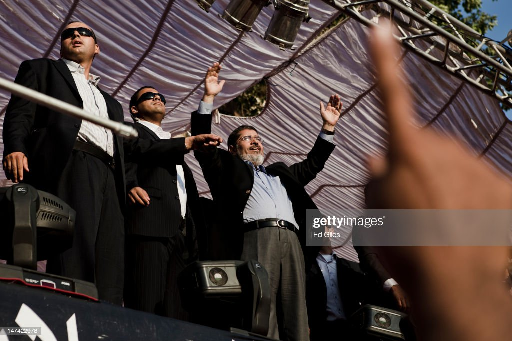 Egyptian President-elect <a gi-track='captionPersonalityLinkClicked' href=/galleries/search?phrase=Mohamed+Morsi&family=editorial&specificpeople=7484676 ng-click='$event.stopPropagation()'>Mohamed Morsi</a> arrives on stage in Tahrir Square on June 29, 2012 in Cairo, Egypt. Accompanied by Egypt's 'Presidential Guard', Morsi made his first post-election appearance in Tahrir Square where he took a symbolic oath of office in front of supporters. Morsi is due to be officially sworn into office on Saturday by Egypt's Supreme Constitutional Court.