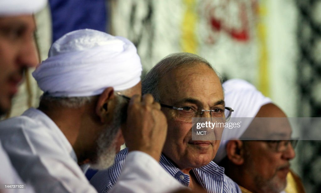 Egyptian presidential candidate Ahmed Shafik, center, talks with dignitaries on stage during a campaign rally in the Upper Egypt city of Aswan, Thursday, May 17, 2012. Shafik is one of 13 candidates running in the first presidential race since Hosni Mubarak was ousted in February 2011. The first round of the elections will take place next week on May 23 and 24.