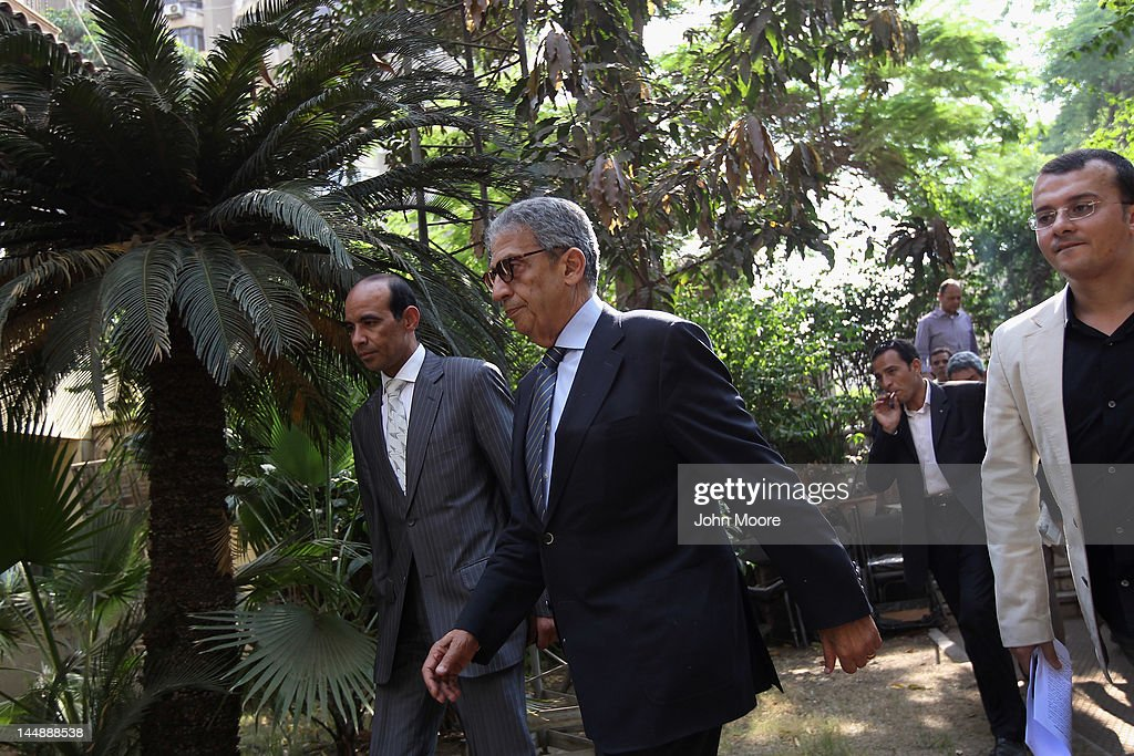 Egyptian presidential candidate <a gi-track='captionPersonalityLinkClicked' href=/galleries/search?phrase=Amr+Moussa&family=editorial&specificpeople=213955 ng-click='$event.stopPropagation()'>Amr Moussa</a> arrives for a press conference on the last day of campaigning on May 20, 2012 in Cairo, Egypt. A Foreign Minister under the government of former President Hosni Mubarak, Moussa is considered one of the leading candidates going into the May 23-24 presidential election.