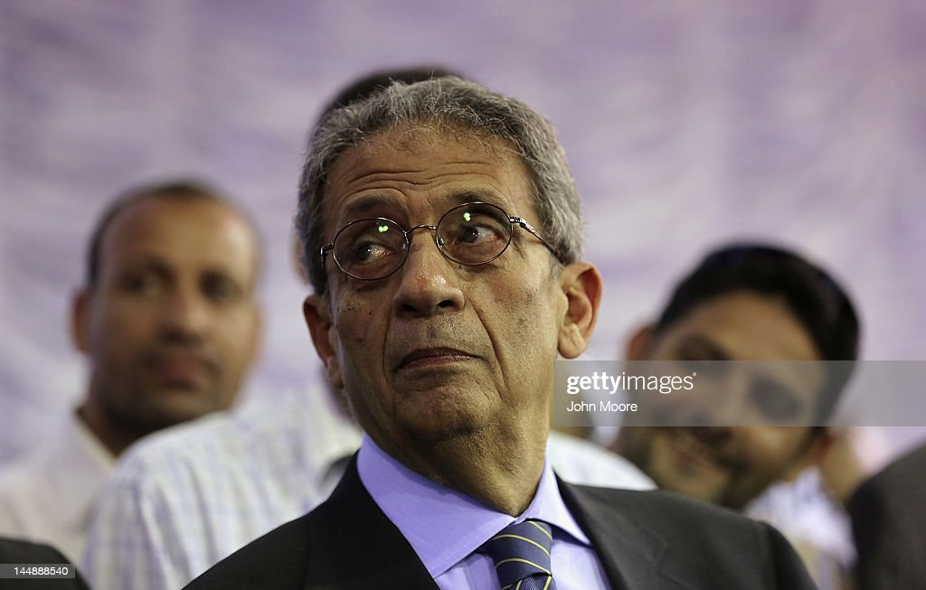 Egyptian presidential candidate <a gi-track='captionPersonalityLinkClicked' href=/galleries/search?phrase=Amr+Moussa&family=editorial&specificpeople=213955 ng-click='$event.stopPropagation()'>Amr Moussa</a> waits to speak on the last day of campaigning on May 20, 2012 in Cairo, Egypt. A Foreign Minister under the government of former President Hosni Mubarak, Moussa is considered one of the leading candidates going into the May 23-24 presidential election.