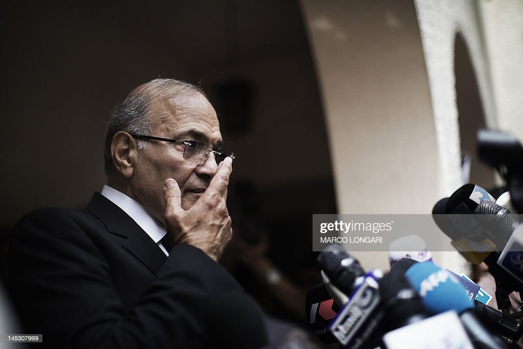 Egyptian presidential candidate and former prime minister Ahmed Shafiq gestures during a press conference in Cairo on May 26, 2012. Shafiq, ousted leader Hosni Mubarak's ex-premier who is set to face a Muslim Brotherhood candidate in a presidential run-off, pledged to restore the country's revolution.