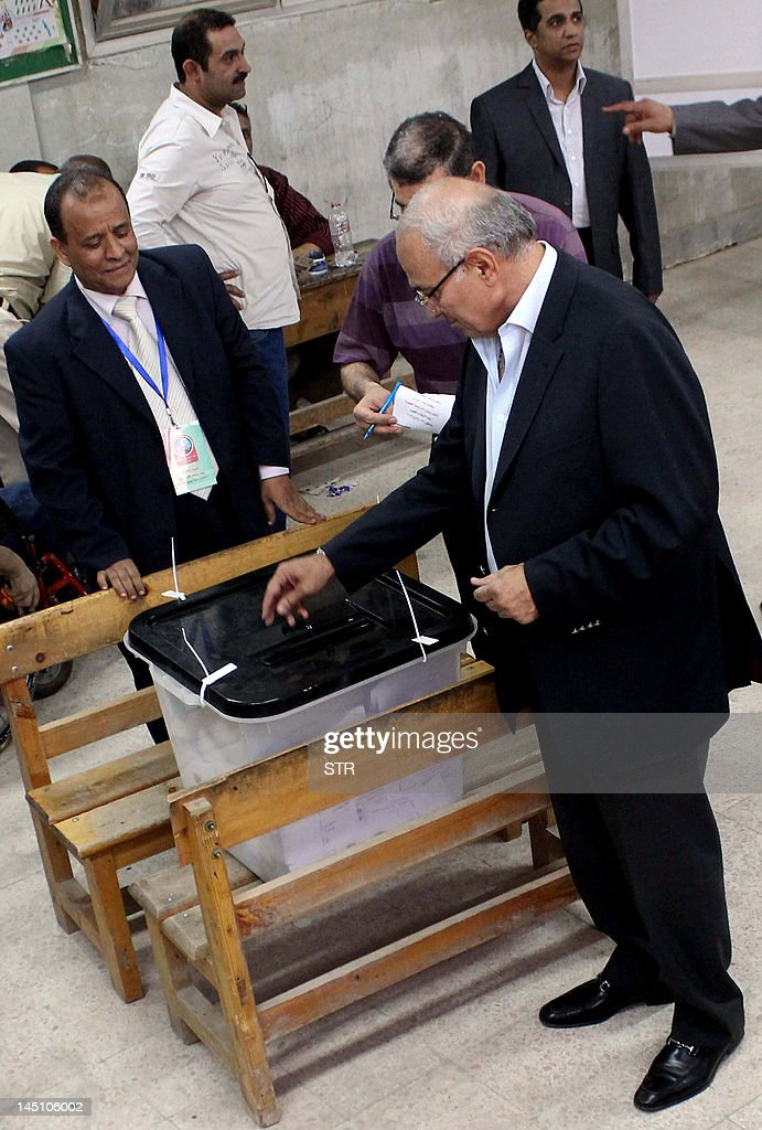 Egyptian presidential candidate and former prime minister Ahmed Shafiq casts his ballot at a polling station in Cairo on May 23, 2012. Egyptians voted in the country's first free presidential elections, with Islamists and secularists vying for power with competing visions of an Egypt liberated of ousted dictator Hosni Mubarak's iron grip.