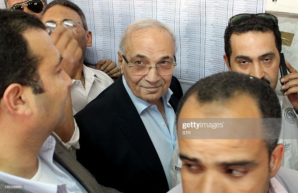 Egyptian presidential candidate and former prime minister Ahmed Shafiq arrives to vote at a polling station in Cairo on May 23, 2012. Egyptians voted in the country's first free presidential elections, with Islamists and secularists vying for power with competing visions of an Egypt liberated of ousted dictator Hosni Mubarak's iron grip.