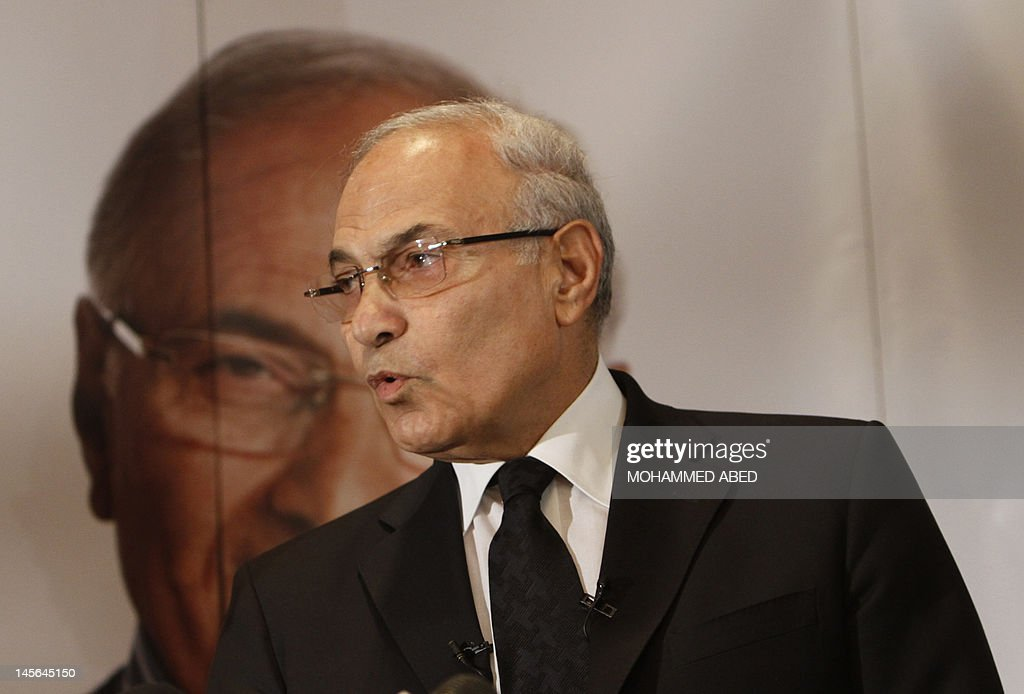Egyptian presidential runoff candidate Ahmed Shafiq addresses a press conference in Cairo on June 3, 2012. After a night of rage following the verdict in ousted president Hosni Mubarak's trial which saw him and his former interior minister sentenced to life in prison while six police chiefs were acquitted, and Mubarak's sons Alaa and Gamal had corruption charges against them dropped on a technicality, offices of Shafiq, Mubarak's last prime minister, were attacked in two provincial towns, according to a security services official.