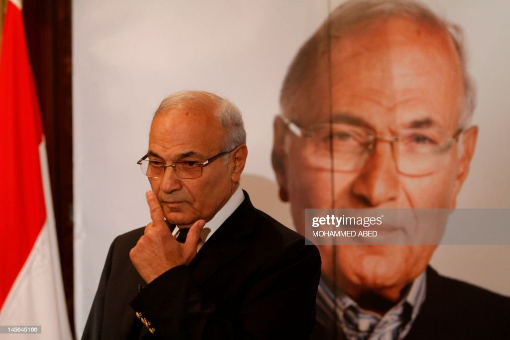 Egyptian presidential runoff candidate Ahmed Shafiq addresses a press conference in Cairo on June 3, 2012. After a night of rage following the verdict in ousted president Hosni Mubarak's trial which saw him and his former interior minister sentenced to life in prison while six police chiefs were acquitted, and Mubarak's sons Alaa and Gamal had corruption charges against them dropped on a technicality, offices of Shafiq, Mubarak's last prime minister, were attacked in two provincial towns, according to a security services official. AFP PHOTO/MOHAMMED ABED