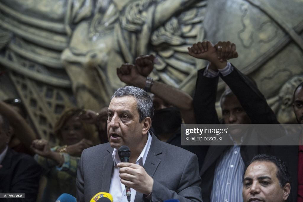 Egyptian Press Syndicate Chief Yahya Qalash attends a protest at the Syndicate's headquarters in Cairo on May 3, 2016 on the occasion of World Press Freedom day, a day after police stormed the headquarters of the journalists' association and arrested two journalists. Egyptian authorities on May 2 ordered the detention of two journalists for 15 days after their arrest on allegations of incitement to protest, a judicial source said. The decision comes a day after police stormed the headquarters of the journalists' association in central Cairo and arrested Amr Badr and Mahmud el-Sakka. A judicial source on Sunday said the pair had been wanted for alleged incitement to protest in violation of the law. / AFP / KHALED