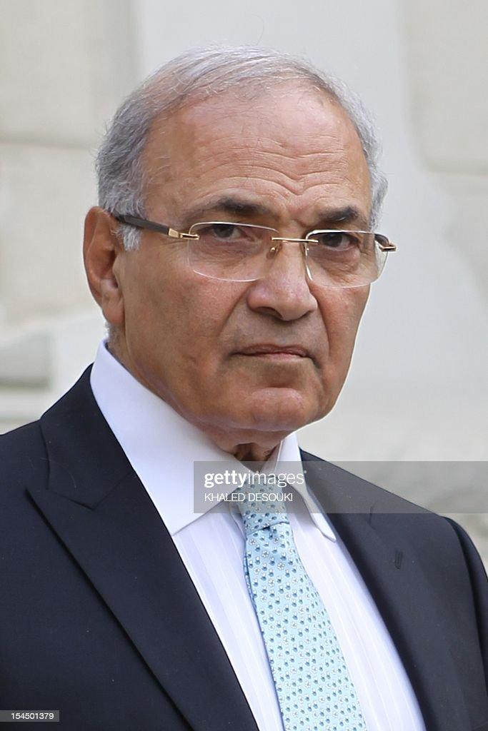 Egyptian Prime Minister Ahmed Shafiq waits for the arrival of his British counterpart David Cameron in Cairo on February 21, 2011, the first trip by a foreign leader to the Egyptian capital since the downfall of longtime president Hosni Mubarak.