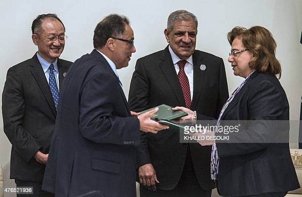 Egyptian Prime Minister Ibrahim Mahlab and President of the World Bank Jim Yong Kim attend a meeting to sign an agreement during an African summit in...