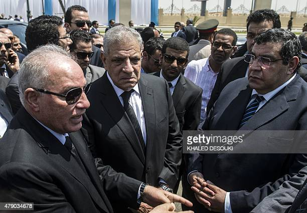 Egyptian Prime Minister Ibrahim Mahlab Egyptian Justice Minister Ahmed elZend and Egyptian judge Shaban elShamy attend the funeral of Egyptian state...