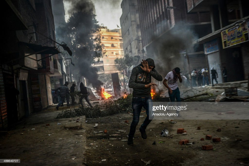 Egyptian pro-democracy protestors and police clash during the demonstration against Muslim Brotherhood's 'terrorist label' in Alf Maskan district of Cairo after Friday prayer on December 27, 2013.