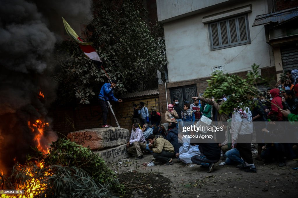 Egyptian pro-democracy protestors and police clash during the demonstration against Muslim Brotherhood's 'terrorist label' in Alf Maskan of Cairo, Egypt, after Friday prayer on December 27, 2013.
