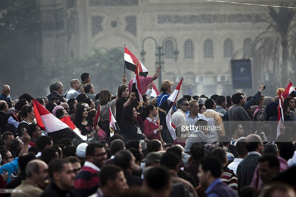 Egyptian protester take part in a demonstration against Egyptian President Mohammed Morsi in Tahrir Square on Friday, November 30, 2012, in Cairo, Egypt. Demonstrations continue in Cairo today after Egypt's Constituent Assembly finalised a draft of the country's new constitution in an overnight voting session late on Thursday. Violent protests have continued for over ten days across the country in response to Egyptian president Mohammed Morsi having awarded himself new constitutional powers, which many believe have been pushed through by the Muslim Brotherhood without inclusive consultation with other members of Egypt's cabinet and political leadership. (Photo by Ed Giles/Getty Images).