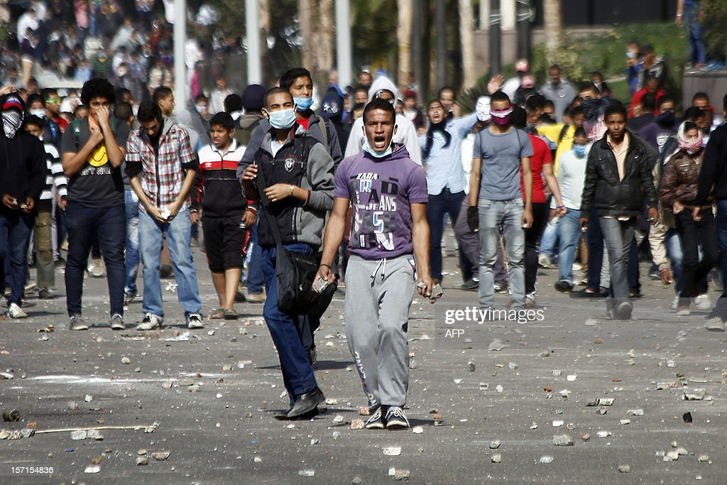 Egyptian protesters clash with security forces on November 29, 2012 in Cairo's Tahrir Square, on the third day of protest over President Morsi's decision to grant himself sweeping powers until the new constitution is ratified in a referendum.