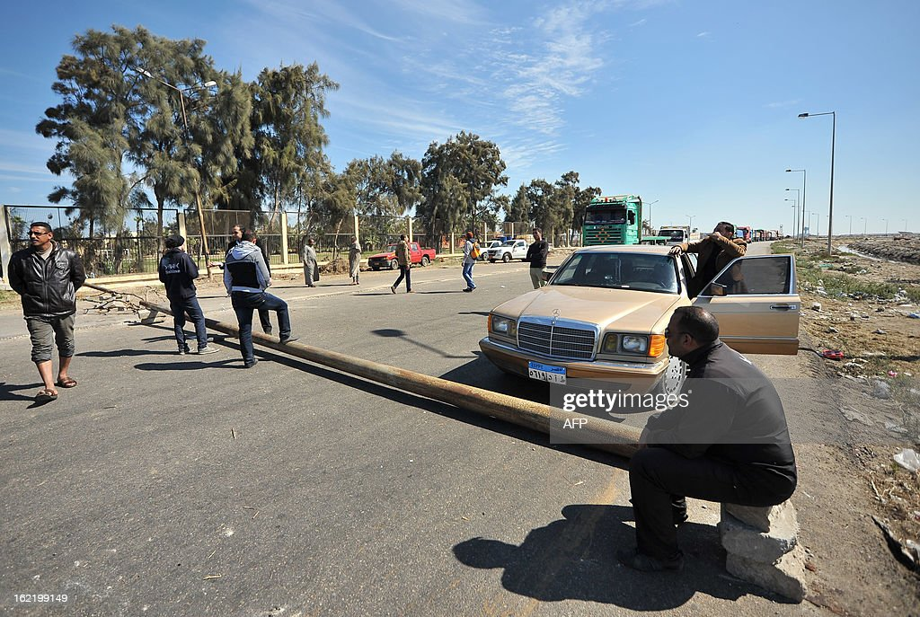 Egyptian protesters close the main road leading to Port Fouad town from the Canal city of Port Said on February 20, 2013. A strike in Port Said entered its fourth day as Egyptian demonstrators demanding justice for protesters killed by police shrugged off a government pledge to inject money into the city.