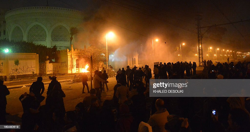 Egyptian protesters gather in front of the presidential palace in Cairo on February 1, 2013, as people took to the streets across the country in a show of opposition to Morsi and his Muslim Brotherhood. Egyptian security used water cannon and fired shots into the air as protesters threw petrol bombs and stones into the grounds of the presidential palace, an AFP correspondent said.