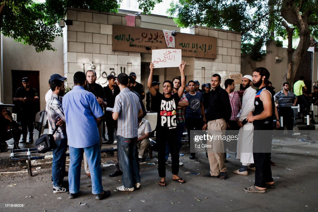 Egyptian protesters gather in front of United States Embassy , the morning after it was vandalised by protesters during a demonstration on Septmebr 12, 2012 in central Cairo, Egypt. Protests are continuing in front of the US Embassy in Cairo, one day after thousands of Egyptians demonstrated at the Embassy compound. Protesters on Tuesday gathered to demonstrate against a US-made film said to be defaming the Prophet Mohammed, whose trailer had recently been released on Youtube and translated into Arabic. Protesters breached the walls of the Embassy compound and removed the American flag from a flagpole, replacing it with a black flag associated with Jihadi Islamist groups. Christopher Stevens, a State Department officer at the consulate in the Libyan city of Benghazi, died in an a later attack along with three other embassy staff after violence erupted over the film. According to an unnamed official the four died after gunmen fired rockets at them.