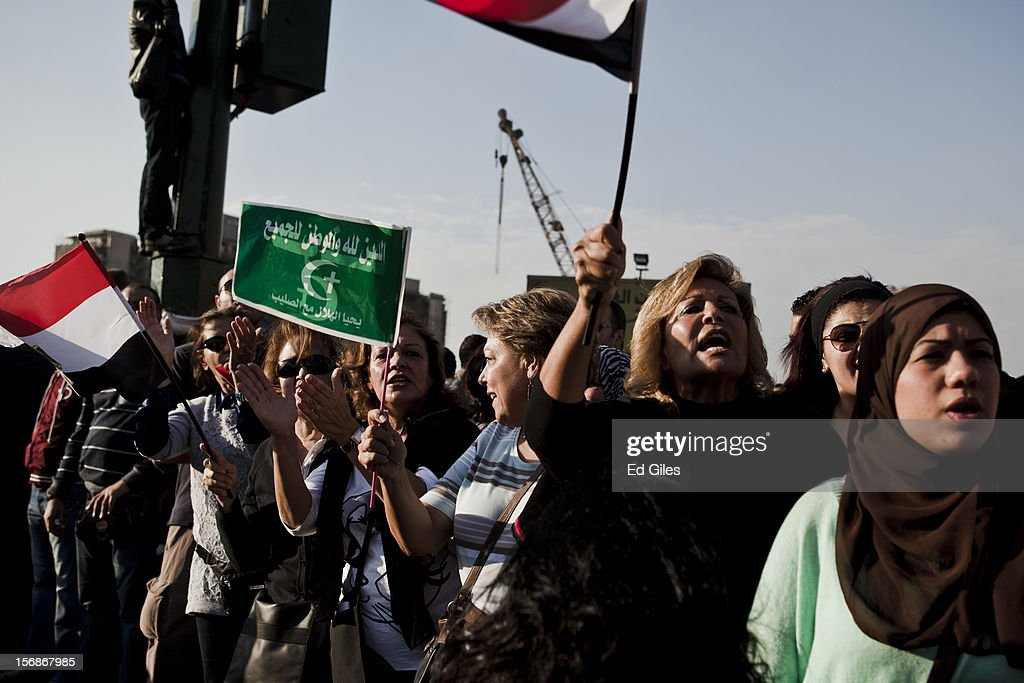 Egyptian protesters gather in Tahrir Square, on November 23, 2012 in Cairo, Egypt. Thousands of Egyptian protesters gathered in central Cairo's Tahrir Square on Friday to protest against a new constitutional declaration issued yesterday by Egyptian president Mohammed Morsi, giving him sweeping powers, and extending the period of deadline for the drafting of Egypt's new constitution by two months. The seven-article declaration renders the president's decrees and laws immune from appeal or cancellation. It also protects both Egypt's Shura Council and Islamist-dominated Constituent Assembly from dissolution by the country's judicial authorities. The demonstration follows a week of violent protests in central Cairo, commemorating one year since a series of deadly protests named 'Mohammed Mahmoud', after the street they took place in, during November 2011.