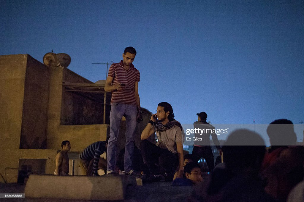 Egyptian protesters gather on a roof inside the grounds of the St Mark's Cathedral in the Cairo suburb of Abasseyya during clashes with Egyptian riot police and groups of plain-clothed men outside the grounds on April 7, 2013 in Cairo, Egypt. Clashes began in and around the Cathedral grounds after a funeral procession for two coptic protesters killed during clashes on April 5 was attacked by unknown assailants on Sunday afternoon. (Photo by Ed Giles/Getty Images).