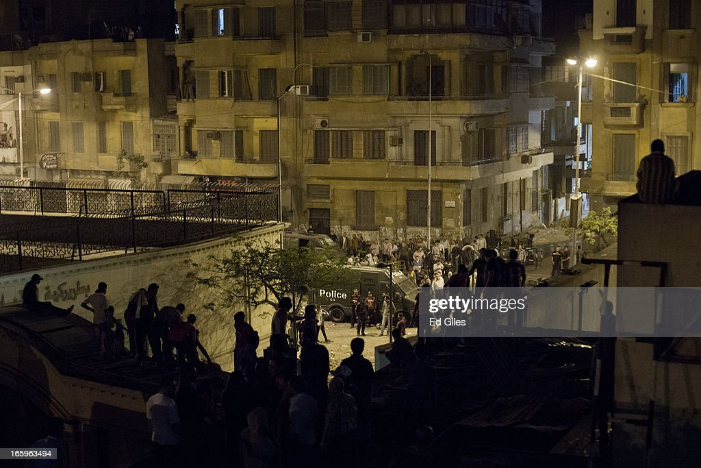 Egyptian protesters gather to watch Egyptian riot police from the walls of the St Marks Cathedral in the Cairo suburb of Abasseyya during clashes with Egyptian riot police and groups of plain-clothed men outside the grounds on April 7, 2013 in Cairo, Egypt. Clashes began in and around the Cathedral grounds after a funeral procession for two coptic protesters killed during clashes on April 5 was attacked by unknown assailants on Sunday afternoon. (Photo by Ed Giles/Getty Images).