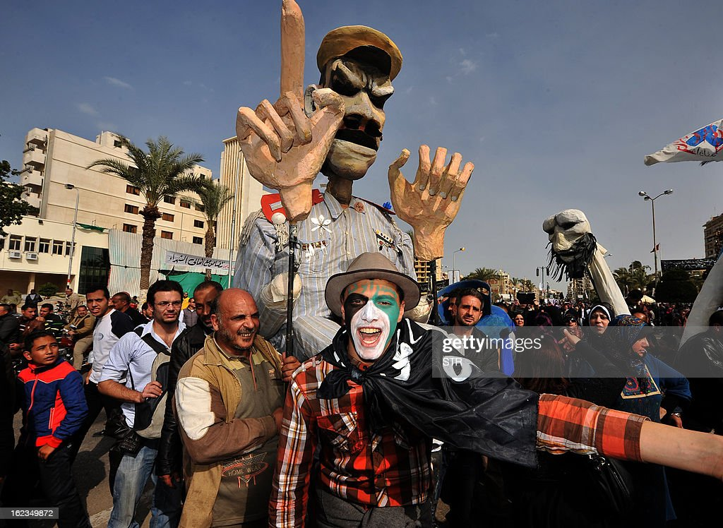 Egyptian protesters hold an effigy depicting President Mohamed Morsi while shouting slogans during an anti-government demonstration in the canal city of Port Said on February 22, 2013. On almost every Friday -- the first day of the Egyptian weekend -- opposition groups have called protests against Morsi and his powerful Muslim Brotherhood, which have regularly degenerated into violence. AFP PHOTO / STR