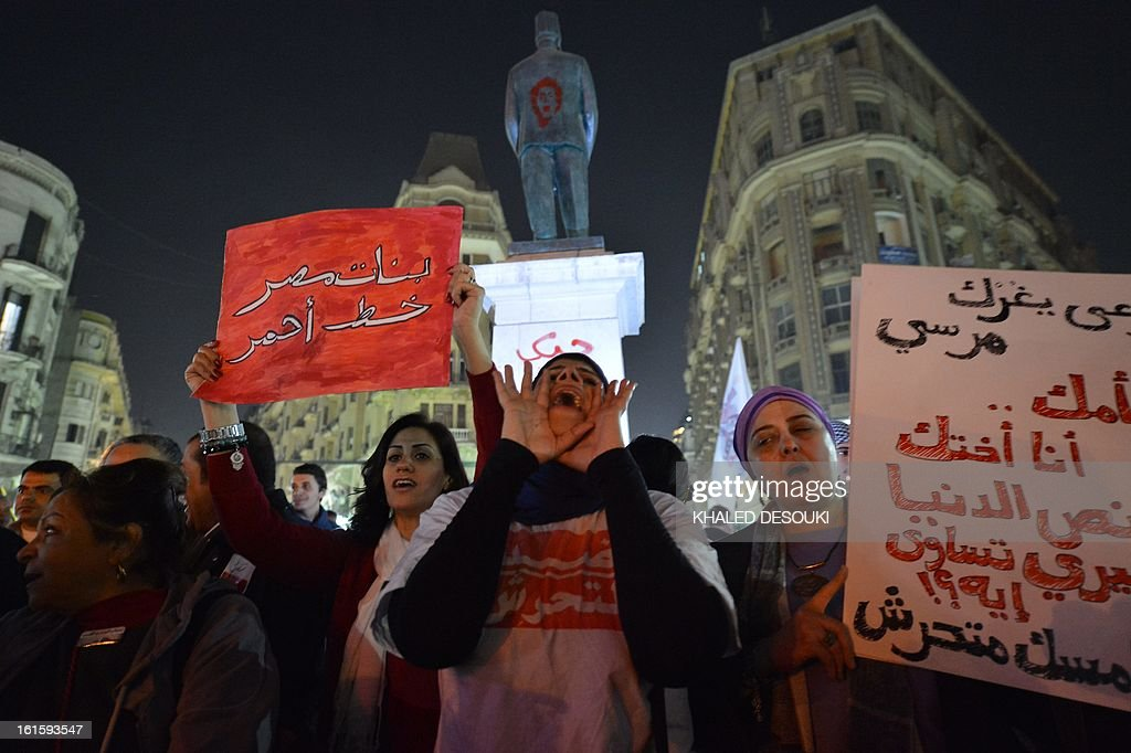 Egyptian protesters hold up placards and shout slogans during a demonstration in Cairo against sexual harassment on February 12, 2013. Egyptian protesters took to the street again to demand an end to sexual violence, as campaigns against the repeated attacks in central Cairo pick up steam. Sexual harassment has long been a problem in Egypt, but recently the violent nature and frequency of the attacks have raised the alarm.