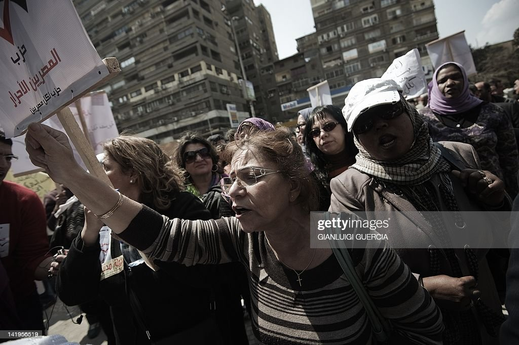 Egyptian protesters including liberal and leftist activists and lawyers demonstrate outside the administrative court in the capital Cairo on march 27...