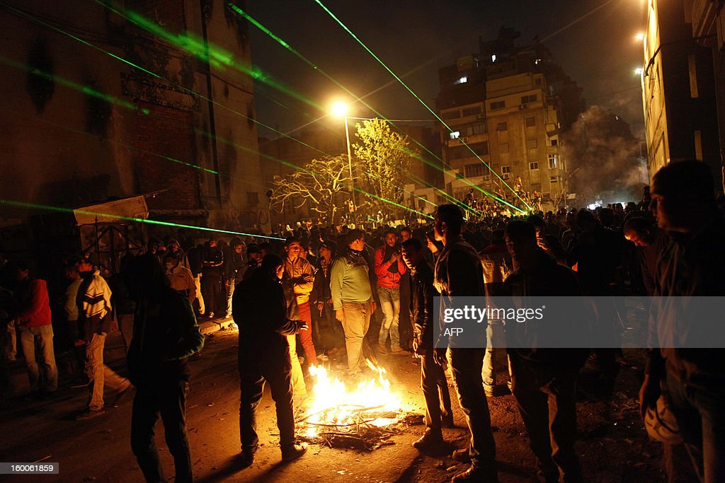 Egyptian protesters light a fire during clashes with riot police near Cairo's Tahrir Square on January 25, 2013. Protesters stormed a regional government headquarters and clashed with police as mass rallies shook Egypt on the second anniversary of a revolt that ousted Hosni Mubarak and brought Islamists to power. AFP PHOTO / MAHMOUD KHALED