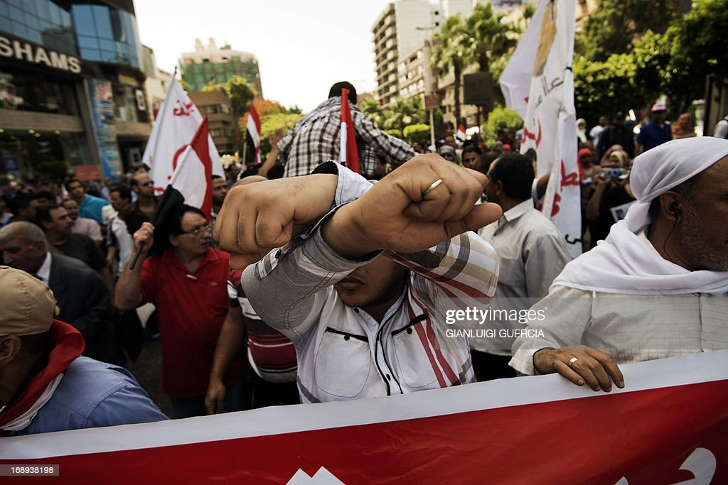 Egyptian protesters march towards Egypt's landmark Tahrir square during a demonstration against President Mohammed Morsi on May 17, 2013 in Cairo. Hundreds of people marched on Cairo's Tahrir Square calling for Morsi to resign and demanding early elections, AFP correspondents and local media reported.